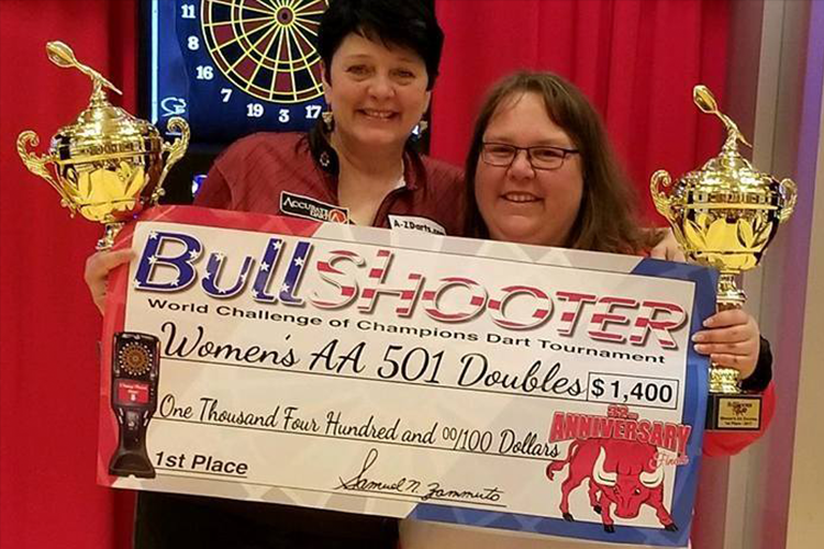 Stacey Pace holding the bullshooter women's AA 501 Doubles check for $1,400
