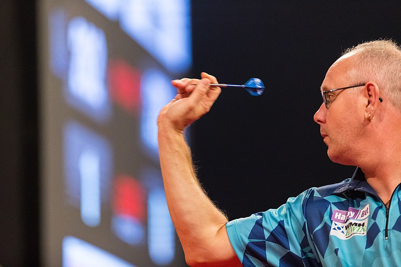Dart Player Ian White poised and ready to throw his steel tip dart