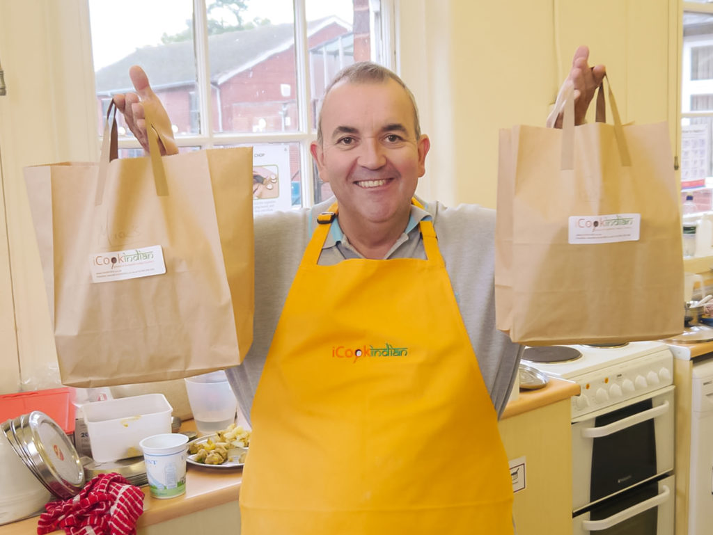 Phil Taylor holding grocery bags
