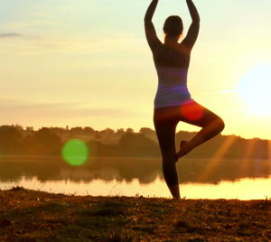 woman-practising-yoga-sunrise-4k-footage-040462721_iconl