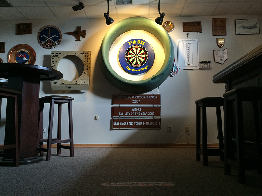 how to put up a dart board cabinet